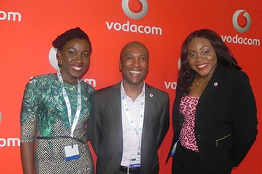Nkosi Kumalo (centre) and Vodacom officials