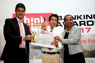 Equity Bank's Rohit Singh and Irene Gitonga receive the award from Craft Silicon's Kamal Budhabhatti