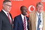 Tony Smallwood and Solomon Ogufere of Vodacom Business and World Telecoms Lab MD Leigh Smith