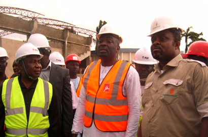 NCC's Dave Imoko, Hon Oyetunde Ojo and a contractor renovating the DBI