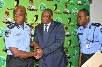 Deputy Inspector General Kachi Udoji, Globacom's Tunde Amunikoro and Commissioner of Police for Cooperative Society A. Glover