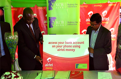 KCB MD Albert Odongo and Airtel Uganda MD Somasekhar VG