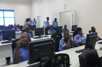 Police officers at the Command Centre of the NPSCS at Police Headquarters