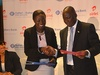 Lucy Quist, Managing Director of Airtel Ghana in a hand shake with Adama Diop, Managing Director of Sahel Sahara Bank