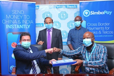 From left is Vijay Kantaria (Director for Business Development, Prime Bank) and Victor Karanja (Head of Operations, SimbaPay