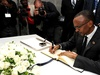Rwandan President Paul Kagame signs the book of condolences