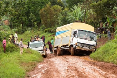 A truck stuck in mud in Buikwe, Uganda - Adam Jan Figel