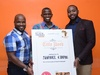 Sam Odima (centre) receiving the title deed from Jumia's Dan Karua and i-Properties' George Kamano