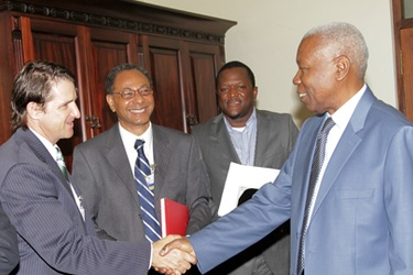 Tanzanian Vice President Dr Mohamed Gharib Bilal congratulates the Wind East Africa team