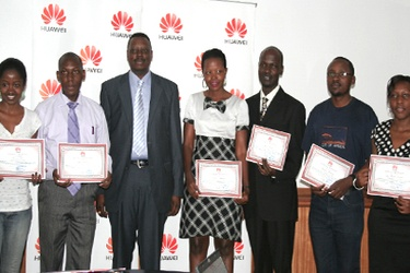 James Mulebeke, Deputy MD of Huawei Technologies in Uganda with students who underwent training