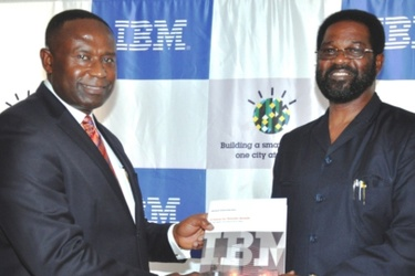 IBM Ghana's Joe Mensah and Accra city Mayor  Alfred Vanderpujie