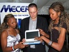 Mustek East Africa MD Corne Combrinck (middle) and models Jay Shaban (left) and Eva Kairang'a admire the latest Mecer classmate
