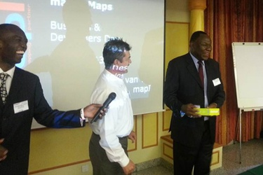 Dr. Bitange Ndemo receives a TomTom device from mapIT MD Etienne Louw