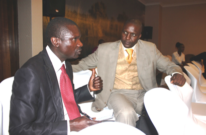 John Churu (L) talks to Budzanani Tacheba