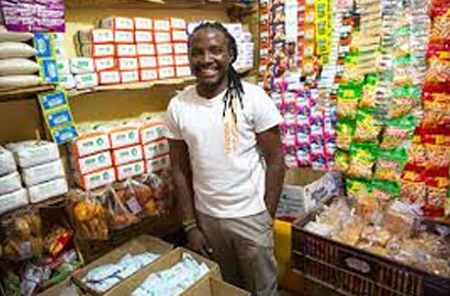 A beneficiary of Smart Duka programme in his shop in Nairobi